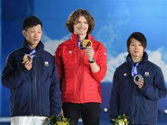 DAY 5:  (L-R) Silver medalist Ayumu Hirano of Japan, gold medalist Iouri Podladtchikov of Switzerland and bronze medalist Taku Hiraoka of Japan celebrate on the podium during the medal ceremony for Snowboard Men's Halfpipe