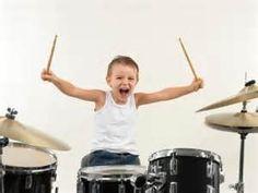 Preschooler Playing with Drum