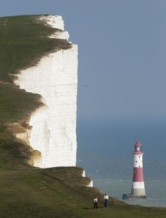 A couple walk along the Seven Sisters cliffs close to the Beachy Head #lighthouse near Eastbourne, #England, Sept. 1, 2011. (Luke MacGregor/Reuters)    http://www.roanokemyhomesweethome.com