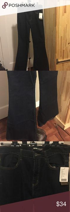 BDG by Urban Outfitters high rise bell bottom jean Brand new with tags BDG by Urban Outfitters Groupie Flate High Rise dark denim jeans. These jeans are super stretchy with yellow stitching details. 32x34 Regular. BDG Jeans Flare & Wide Leg