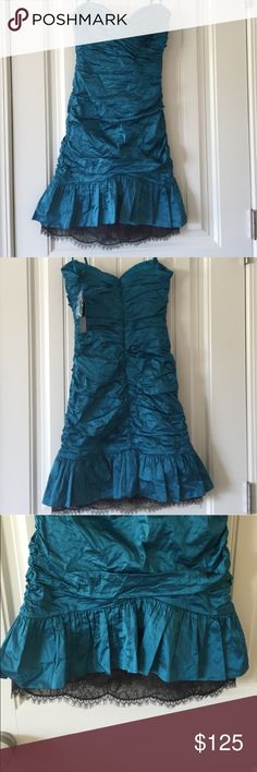 NWT‼️ Teal bcbg MaxAzria cocktail dress w/ lace DT NWT‼️ Teal bcbg MaxAzria cocktail dress w/ lace details ! Beautiful , flirty, sexy special occasion dress ! Oringnaly $378 I bought it for $264 so at $125 it's a HUGE discount but make me a offer I'm open to all reasonable offers !! From a smoke/pet free home !! BCBGMaxAzria Dresses Strapless