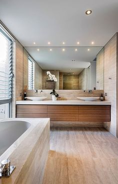 POWDER ROOM AND GUEST ENSUITE  VANITY-  looking for a simple vanity like this.  White counter top, blonde wood draws below.  Obviously much smaller to suit the space.  Floating