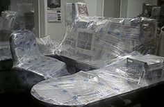 saran wrap - Ah - how many times did we do this to someone's cube.  This is one reason you never, ever take a vacation from an engineering company