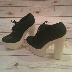 Black and white platform oxfords Chunky faux leather oxford lace up platform booties. New in box Shoes Ankle Boots & Booties