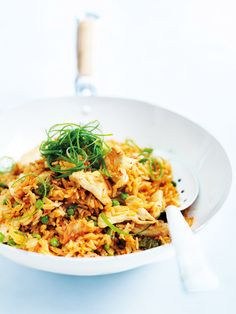 kimchi fried rice 2 cups (400g) jasmine rice (see tips) 1 tablespoon vegetable oil 1 teaspoon sesame oil 200g chicken breast fillets, thinly sliced 1 x 4cm piece ginger, peeled and grated 1 cup (280g) kimchi (see tips) 1 cup (120g) frozen peas, thawed ¼ cup (60ml) soy sauce 2 green onions (scallions), shredded