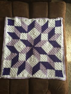 Sarikumar's Mini Carpenter Wheel baby blanket ~ 64 corner-to-corner (C2C) squares joined in quilt-style star pattern. Link to Facebook pattern on Ravelry page.  #crochet #afghan #throw