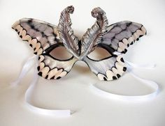 Stunning hand-painted leather masks, pins, and more.