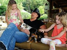 Trace Adkins, country singer, pictured here with daughter Brianna, 6, left, who suffers from life-threatening food allergies. Adkins is currently a spokesperson for the Food Allergy & Anaphylaxis Network (FAAN).