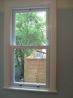 PVC-u Sash Window with Timber Architraves, Window Board Nosing Trims for an Authentic Traditional Finish - London