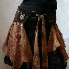 Dark Brown Suede and Chiffon Tribal Fusion/Tribaret Belly Dance Belt with Antique Brass Metal Coins. $65.00, via Etsy.