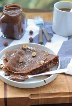 GLUTEN~FREE CHOCOLATE CREPES * 2 large eggs  * 1 Tablespoon sugar  * 3/4 teaspoon salt  * 1 cup milk  * 2 Tablespoons melted butter, plus extra butter for cooking  * 1/2 cup rice flour  * 1/4 cup cocoa powder  * 1/4 cup potato starch  * powdered sugar or whipped cream (optional)