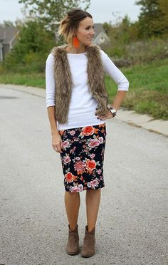 0df5572229 Floral pencil skirt, fur vest, and ankle boots - perfect for transition  periods between