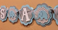 Elephant Chevron Stripe and Polka Dot Its a Boy or Name Banner Baby Light Blue, and Gray Baby Shower Birthday Party Decorations Banner. $24.00, via Etsy.