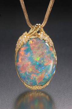Opal pendant with diamonds and gold, 22 x 35 mm. R. W. Wise Collection. (Photo © Jeffrey Scovil):