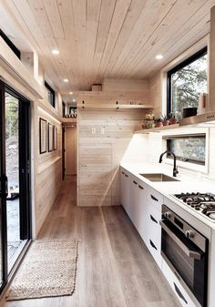 The tiny home is clad in a stunning maintenance-free black corrugated metal siding. Twelve windows and a sliding glass door allow for plentiful natural light. tiny homes Draper by Land Ark - Tiny Living Tiny House Plans, Tiny House On Wheels, Tiny Houses For Sale, Little Houses, Tiny House Living, Living Room, Tiny House Design, Tiny House Luxury, Modern Tiny House