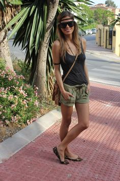 Lightweight basic black top- Massimo Dutti, breezy olive green cuffed shorts- Zara, Leapord print flats- Primark, Necklace from Misako and black studded sunglasses- Aldo