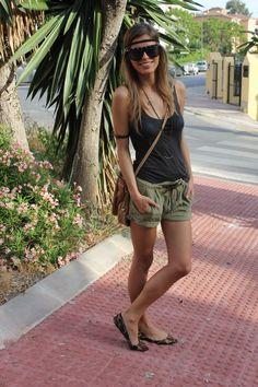 Lightweight basic black top- Massimo Dutti, breezy olive green cuffed shorts- Zara, Leapord print flats- Primark, Necklace from Misako and black studded sunglasses- Aldo