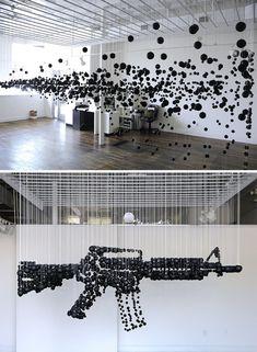 1200 Black Ping Pong Balls Form a Deadly Assault Rifle - My Modern Metropolis