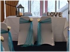 Bride & groom's chairs with pale blue organza sashes  Want your own quote? Then email me with your ideas! hello@beckiemelvinevents.co.uk  More styles can be seen at www.beckiemelvinevents.co.uk