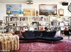 Eclectic library living room with black modern sofa