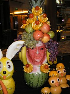A lady adorned in beautiful fruit, from a seminar on Fruit and Vegetable art on the cruise ship, Independence of the Seas.     I am addicted to good food