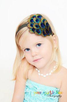 not saying i'm gonna wear a peacock in my hair...but whatever I have, my flowergirl will have the same.