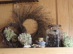 natural materials decorate small house thanksgiving mantle, seasonal holiday d cor, thanksgiving decorations, wreaths, Grapevine wreath layers nuts Indian corn and the beauty of fresh hydrangea blooms