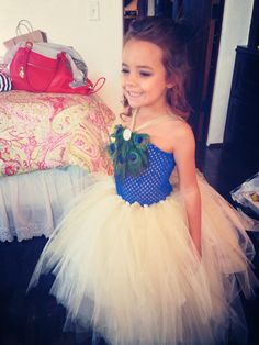 Little Peacock flowergirl #differentcolors #peacock #peacockwedding #ssi #villadesuenos #flowergirl @georgia lin. Rentals @Amanda Newton