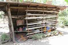 the importance of play: playhouse for children in Inigodawela.Some playhouses are made out of wood, some out of slim bamboo shoots. Others have been covered with cloth or palmyra leaves. The materials are different, but the purpose is the same: to encourage play.