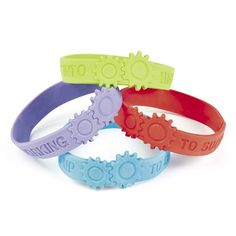 """Each printed with a motivational saying. Blue – Gearing To Learn, Green – Kicking Into High Gear, Purple – Working Together & Red – Engineered To Succeed. Rubber. Measures: 7 1/4"""" circle."""