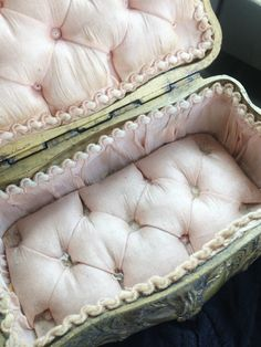 Soft pink tufted interior top and bottom.Traditional rocaille ornamentation and turned legs.Appx 6