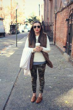 White sweater + fur vest + camo jeans + tan oxfords