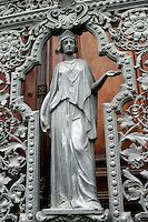 Detail of a bronze woman figure in Greco-Roman attire in the centre of the wrought iron gates in front of the old Presidential Palace in the Catete neighbourhood in Rio de Janeiro, Brazil.