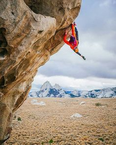 www.tickthatpitch.com climber getting all burly on a steep route. Not a bad view to say the least.