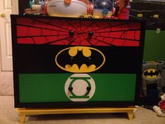A dresser makeover for my superhero loving little guy. It was previously painted yellow. He chose the superhero symbols, I painted them with wall paint and coated with clear acrylic.