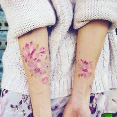 Beautiful water colour flowers tattoo