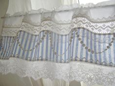 I love the detail on this...curtain, bedskirt, whatever!