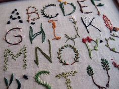Nursery Sampler from Stitched Gifts by Jessica Marquez via Alicia of Duduá. More pics of projects, studio, and cats if you follow the link... Alphabet, embroidery, sampler, nursery