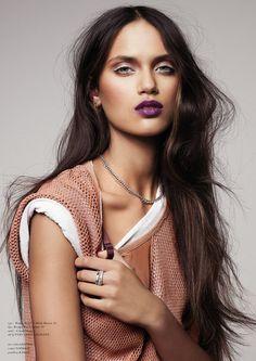 purple lips, white eye-liner, chocolate locks