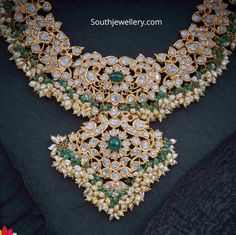 22 Carat gold antique peacock pachi necklace adorned with polki diamonds, rubies, emeralds and pearls by Navrathan jewellers. Indian Jewelry Earrings, Royal Jewelry, Temple Jewellery, Gold Jewelry, India Jewelry, Gold Necklaces, Diamond Jewelry, Bridal Jewelry Sets, Wedding Jewelry
