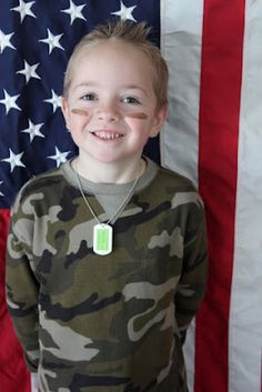 get each kids picture in their army, navy, marine t-shirts (or camo) in front of american flag!
