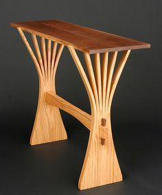 Abanico Table: Red Oak & Walnut by Seth Rolland. Hall table made from solid red oak legs that have been cut and *steam bent:steam bend*, and a top of *bookmatched:bookmatching* walnut. Shipped flat; minimal assembly required. The top is easily installed and will not slip off; the four central legs have dowel rods which fit into holes in the bottom of the tabletop. Signed and dated on bottom.