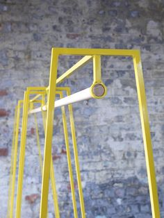 Image of 'A' clothes rail in yellow