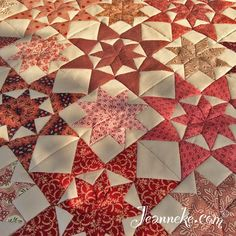 "The start of my Alabama Star quilt, 8"" blocks in red,orange and pink. Free pattern at http://iloapp.jeanneke.com/blog/www?Home&post=172"