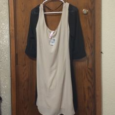 NWT cream and black Charlotte Russe dress size XL Brand new with the tags still on! Charlotte Russe Dresses Long Sleeve
