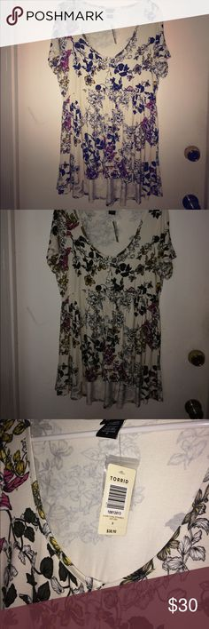 NWT Torrid Babydoll Top - size 0, floral Super cute, brand new with tags babydoll style Torrid top in size 0.  Gorgeous floral print with creme colored background and pink, white, green and yellow in the print.  Working buttons down the front with elastic empire waist.  Material also has stretch.  No signs of wear, no rips, stains, etc. and ships from smoke free home. torrid Tops Blouses