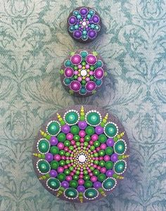 Colorful mandala stones by Australian artist Elspeth McLean