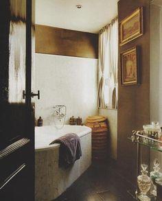 Bathroom styling: Bronze cart, artwork.