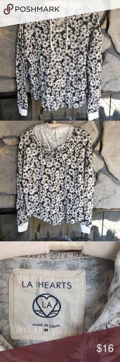Daisy print long sleeve hoodie shirt Long sleeve pullover hoodie top with white daisies on black background print.  Drawstring hood, front pockets.  Good condition, smoke free home. LA Hearts Tops Sweatshirts & Hoodies