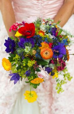 Amazing bright wildflower bouquet - these colors would be gorgeous to work into the centerpieces in the barn!